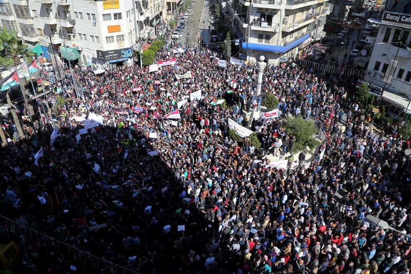 Palestinians take part during a protest against a social security law in Ramallah on October 2.