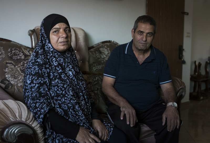 Fatma (left) and Jamal Elayan sit for a portrait in their temporary home