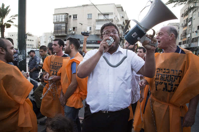 A man speaks into a megaphone