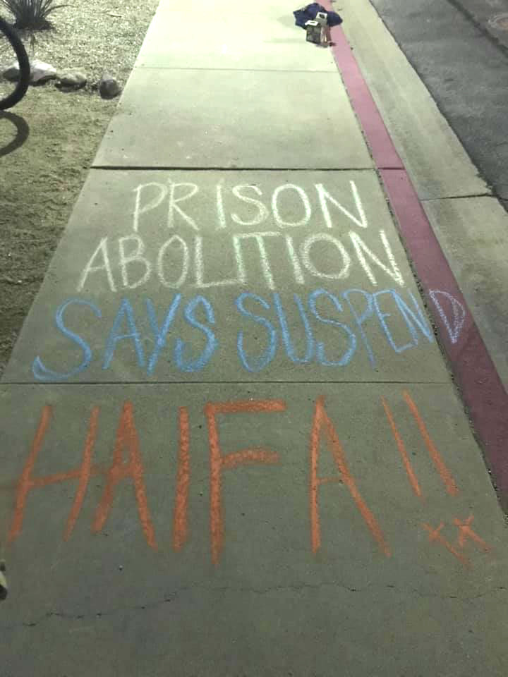 Students wrote Prison Abolition says suspend Haifa! in chalk on Pitzer campus.
