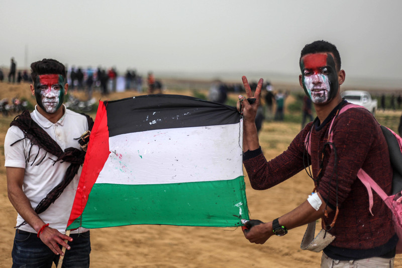 Palestinians rally at Gaza border to mark protest anniversary