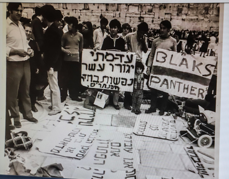 """A black and white poster from the 1970s that reads: """"Until when will ten people have to live in one room? / The Panthers"""""""