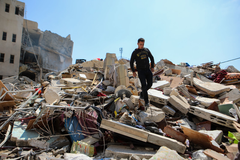 Man stands atop rubble