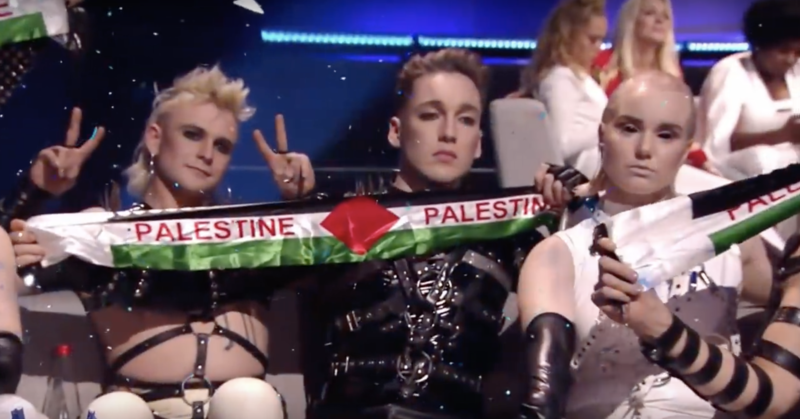 Members of Iceland bang Hatari hold Palestine flag scarves
