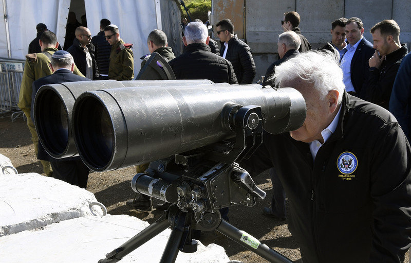 Man uses enormous binoculars
