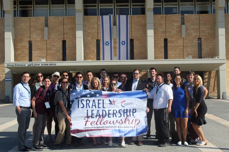 Trip participants stand outside the Knesset