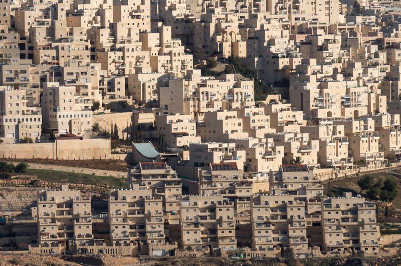 Apartment buildings cover a hillside