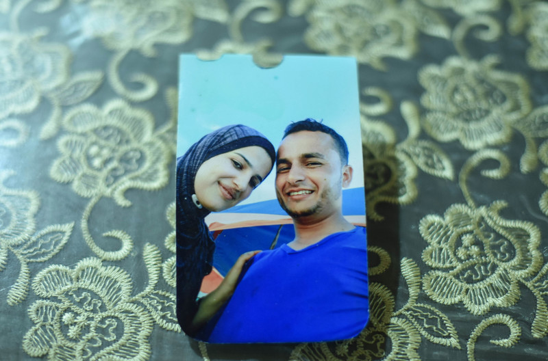 A color photo of a smiling couple lies on a table