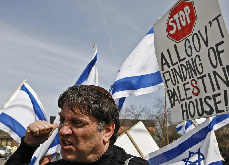 Close up of a man's face and Israeli flags