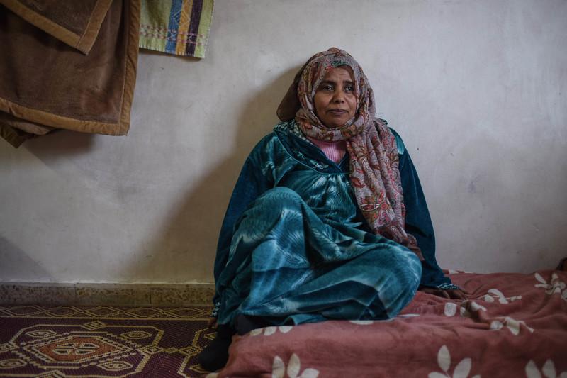 A woman sits
