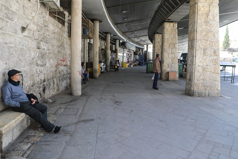 Man sits on a bench in empty market