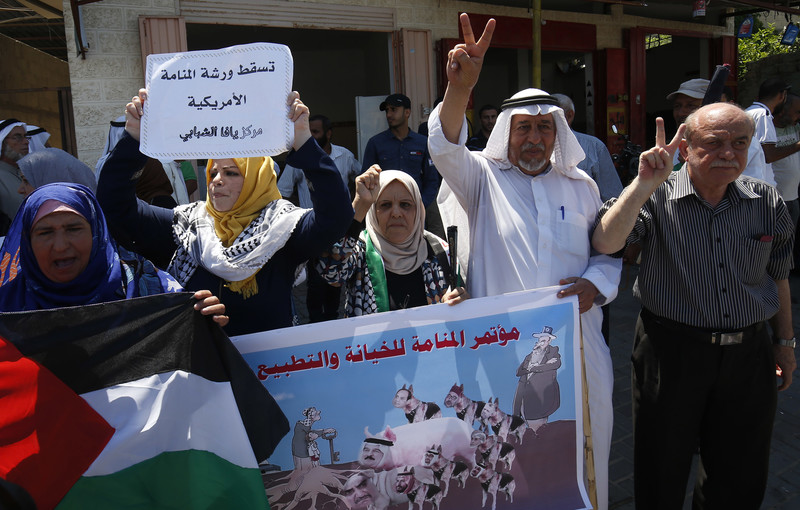 People hold up banners during a demonstration