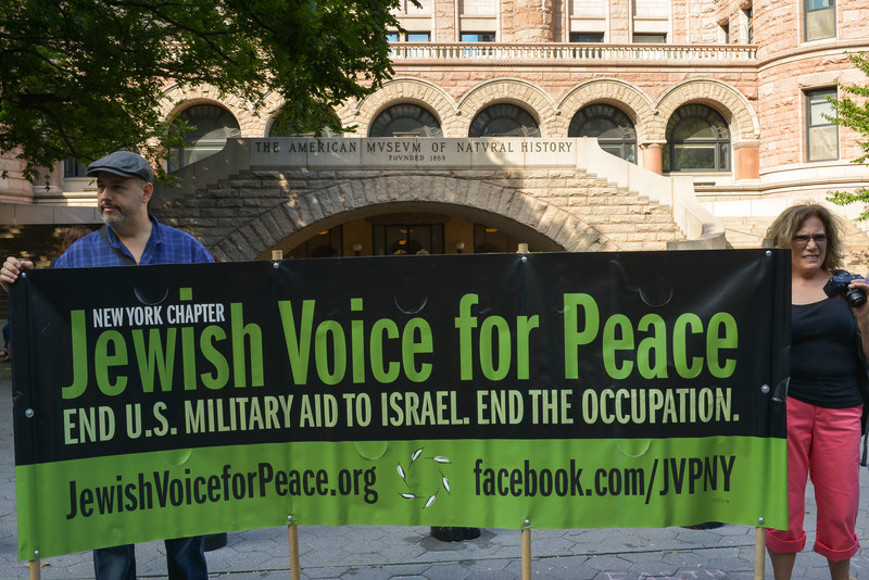 Protestors hold up a banner urging the US to end military aid to Israel