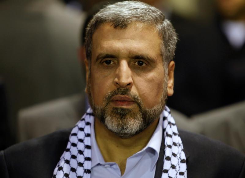 Man wears Palestinian scarf around his neck