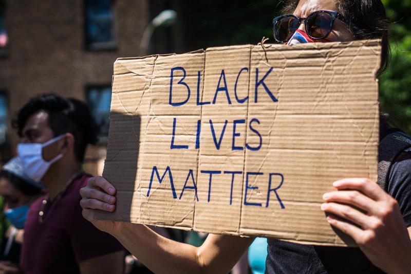 Protester holds sign reading Black Lives matter