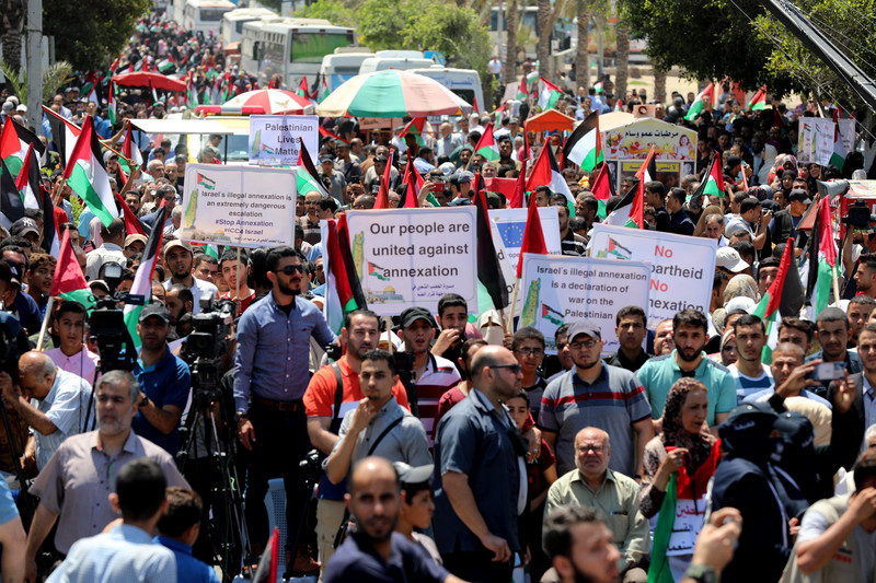 People march with placards and flags