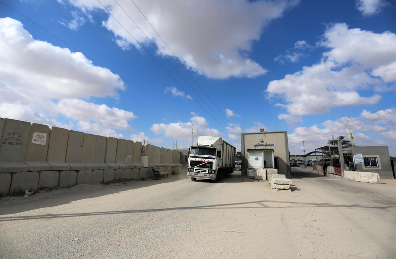 Truck drives between building and separation wall