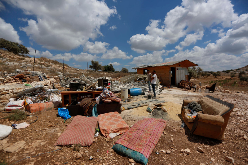 Damaged furniture and rubble on open land