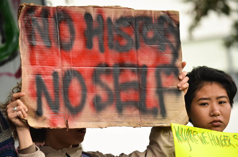 A protester holds a sign