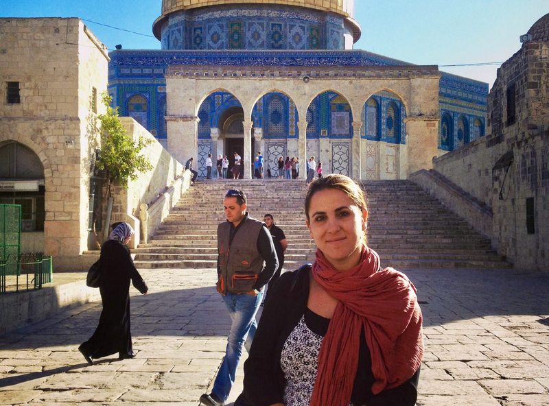 Woman stands outside the Dome of the Rock