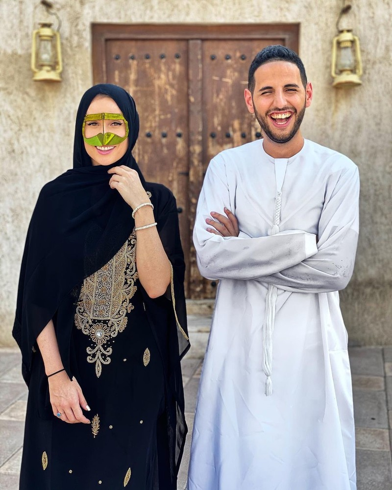 A man and woman dressed in traditional Emirati clothing