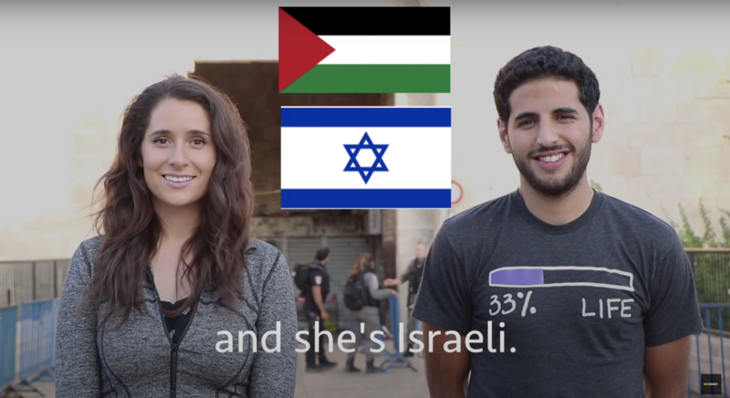 Two people stand side by side with Palestinian and Israeli flags between them