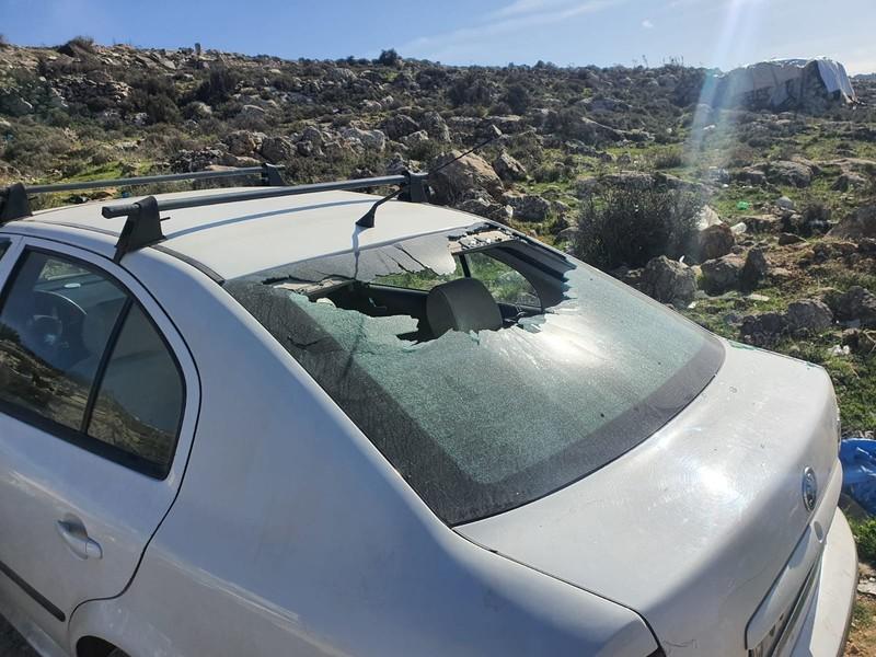 Sun shines on the broken back window of a car