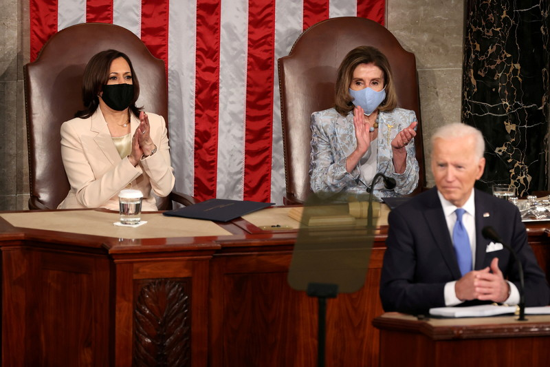 Harris and Pelosi applaud Biden