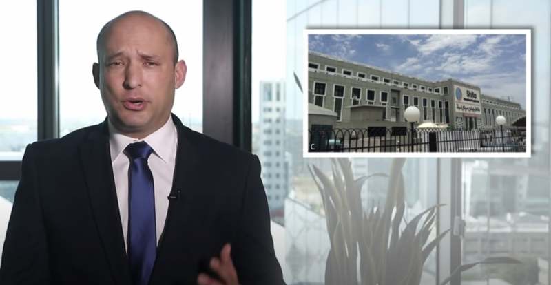 Man speaks on screen with photo of building inset