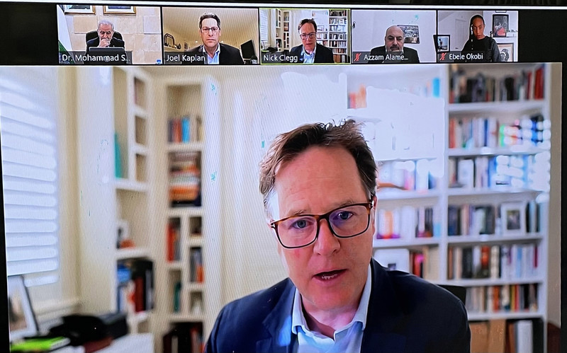 Four men shown on screen in a virtual meeting