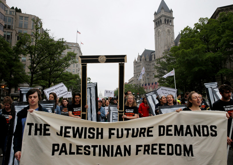 Marchers with banner that reads The Jewish future demands Palestinian freedom