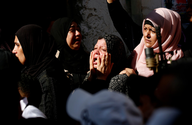 Women weep and mourn