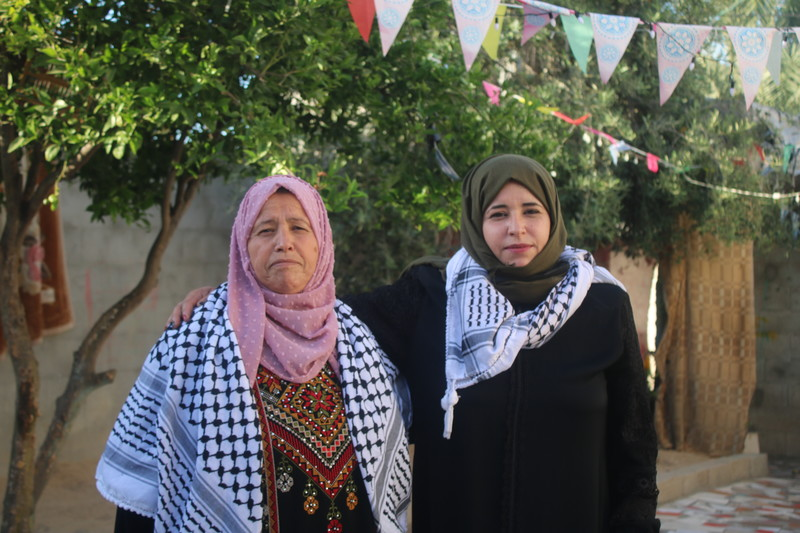 Two women pose for the camera