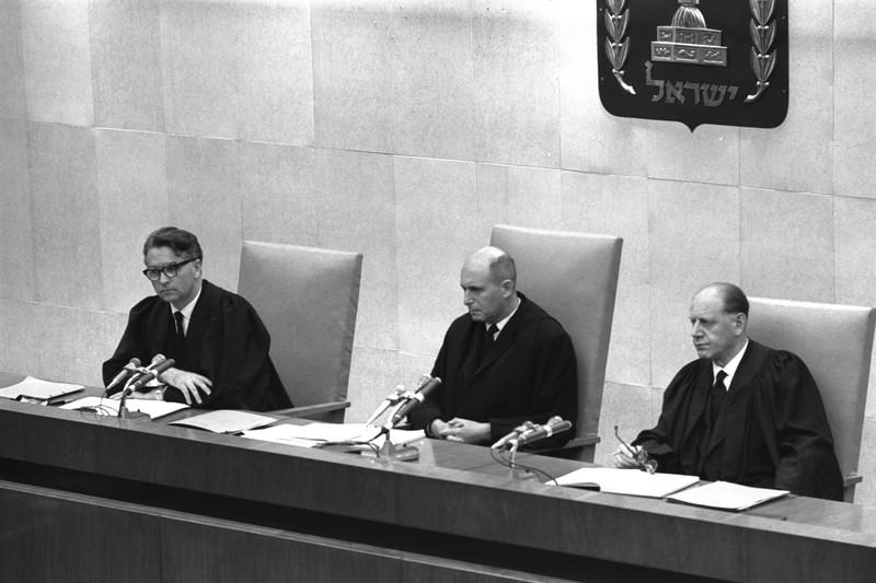 Three judges sit in an Israeli court