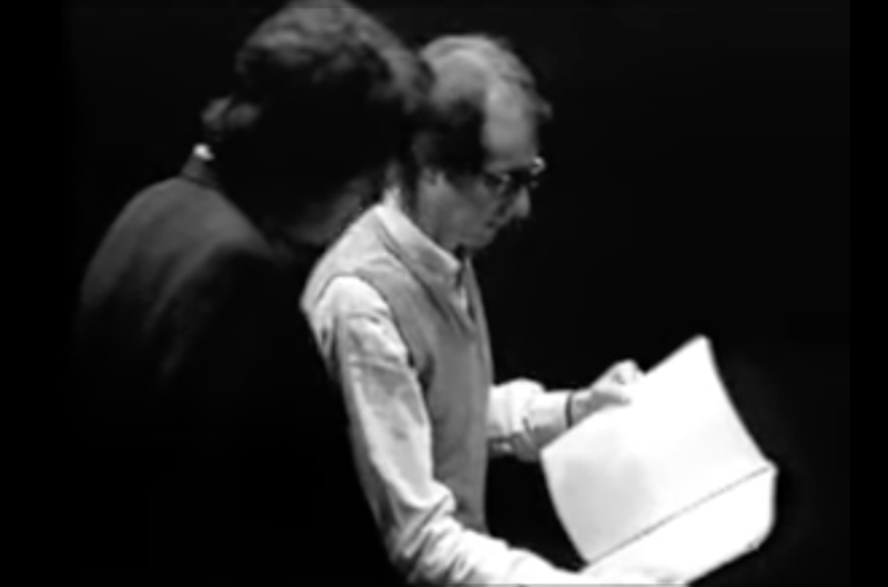 A man reads from a script to an actor