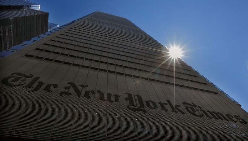 Sun shines behind New York Times building