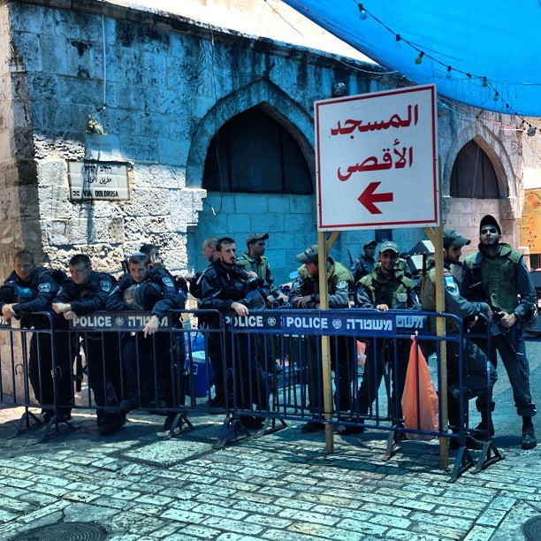 "Oh the symbolism of this photo! Israeli apartheid colonialist army standing next to sign directing worshippers to ""aqsa mosque"" #ramadan #aqsa #jerusalem #palestine on Instagram"
