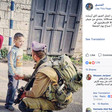 Screenshot of COGAT Facebook post of photograph of kneeling Israeli soldier carrying rifle shaking the hand of a young Palestinian boy as a girl stands nearby