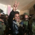 """Muhammad Bilal Tamimi smiling, raising a """"victory"""" sign as Israeli occupation soldiers abduct him from his home on 11 January."""