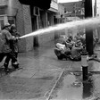 Civil rights protesters blasted by fire hoses.