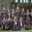 Palestinian schoolchildren in uniform pose for a picture.