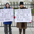 """Protesters stand in front of the White House with signs reading """"AIPAC says jump! Congress says how high?"""" and """"Zionism needs/feeds anti-Semitism, no more $ for a rogue racist state"""""""