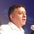 Avi Gabbay speaking into a microphone.
