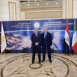 Israeli energy minister Yuval Steinitz andIsrael's ambassador to Egypt David Govrin stand in front of a backdrop to the First Ministerial Meeting of the Eastern Mediterranean Gas Forum.