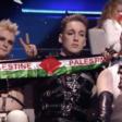 Members of Iceland bang Hatari hold Palestine flag scarves