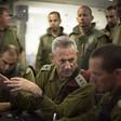 Men in military uniforms confer