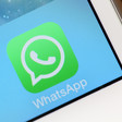 A closeup of the WhatsApp icon on a smartphone