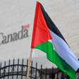 Palestinian flag flies in front of building marked Canada