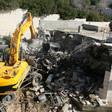 Bulldozer destroys a building