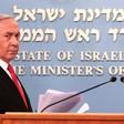 Benjamin Netanyahu stands behind podium